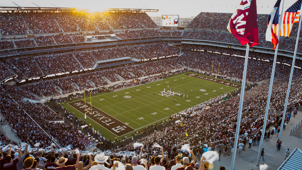 Wide shot of Kyle Field with full of audience watching a football game.