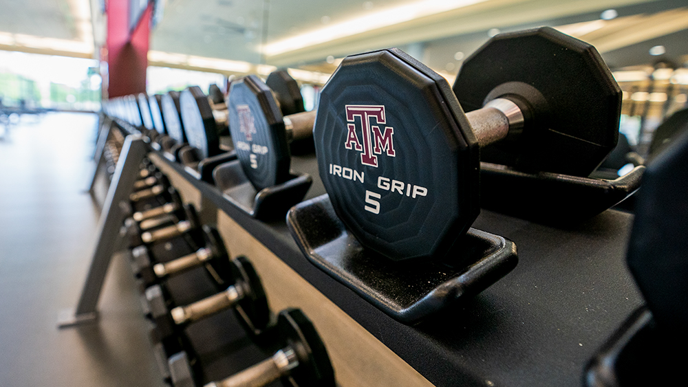 Weight with A&M logo in the recreation center.