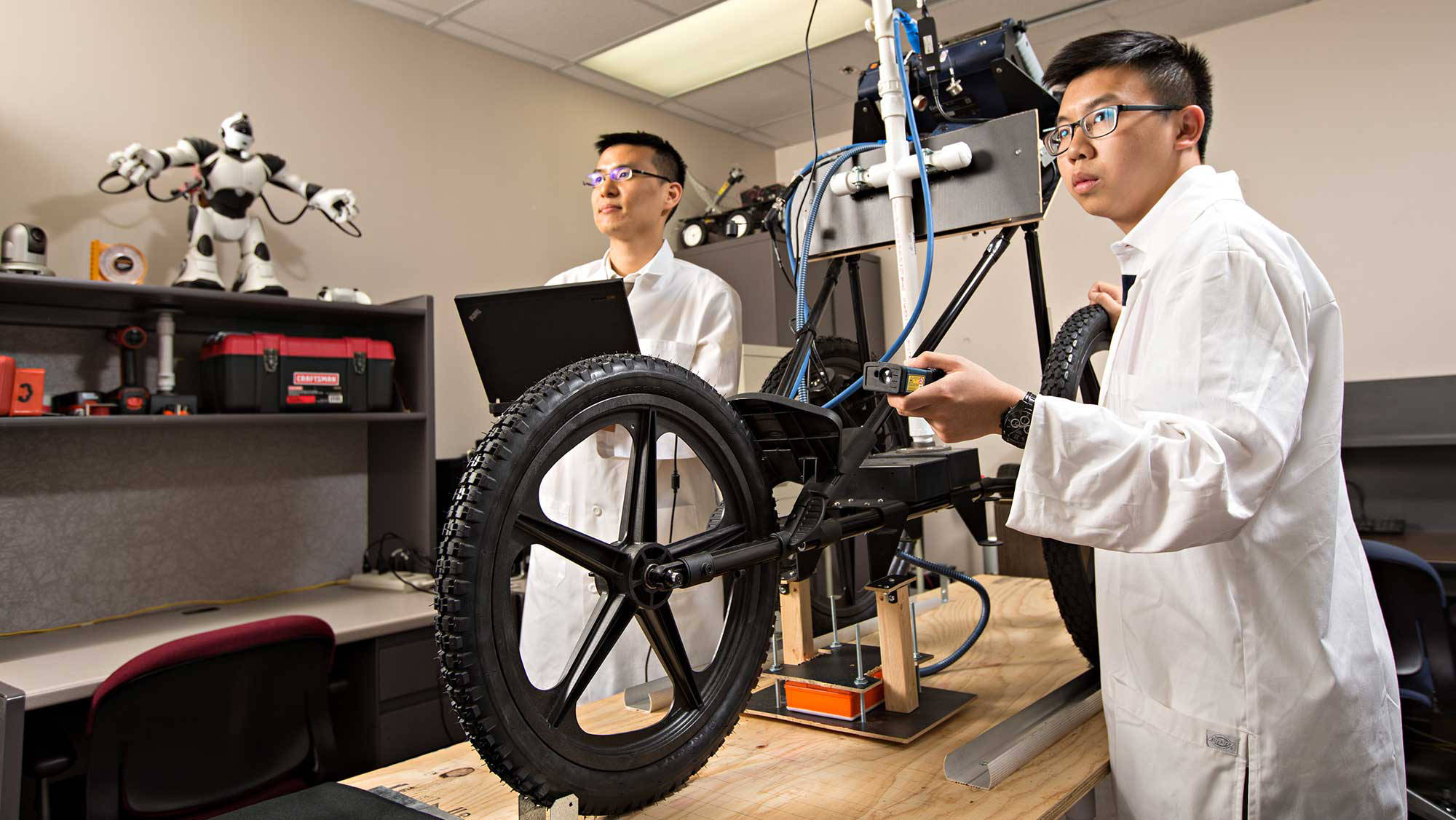 students research robot vehicle mechanics