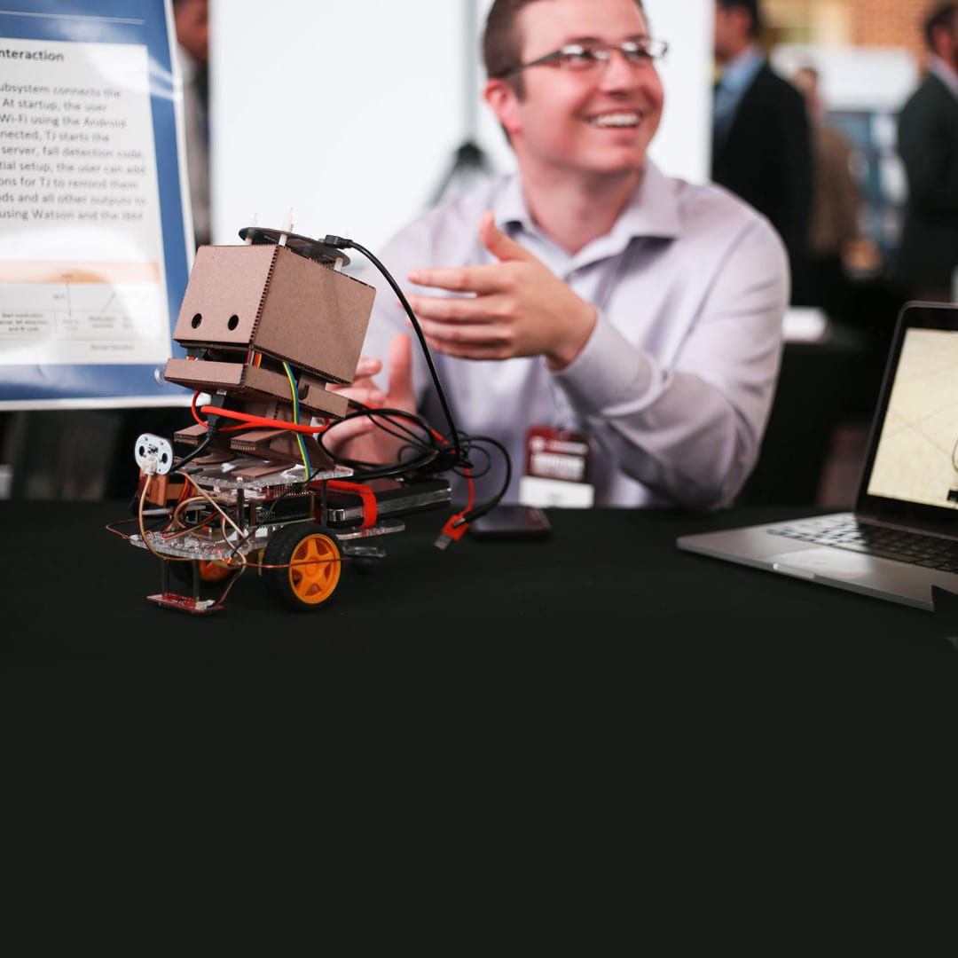 student with a robot in engineering project showcase 2018
