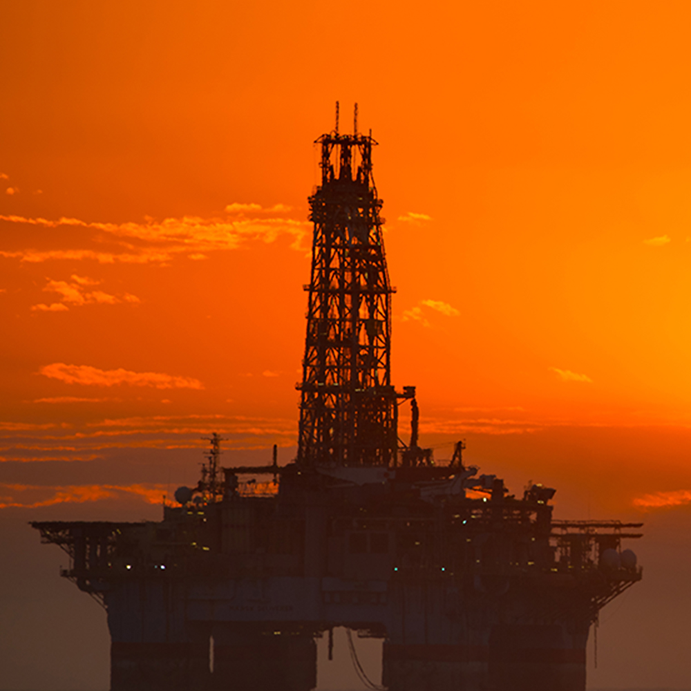 oil rig with sunset in background