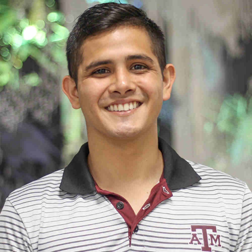 Undergraduate petroleum engineering student William Villalobos wearing polo with TAMU logo