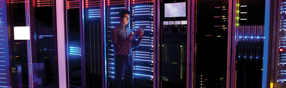 Young man in server room
