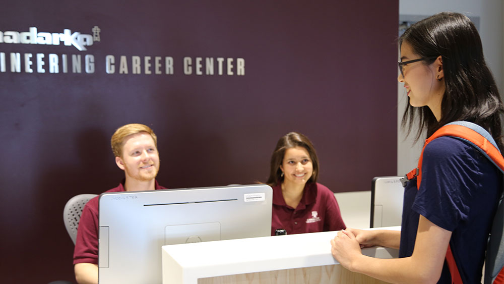 Student at career center front desk.