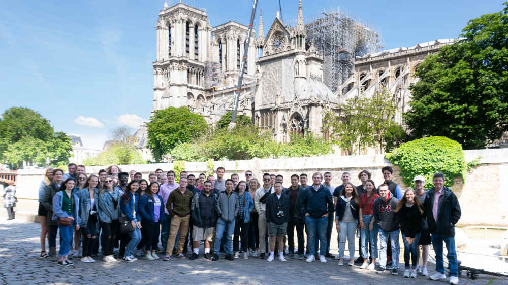Group of students in front of the Notre Dame Cathedral.