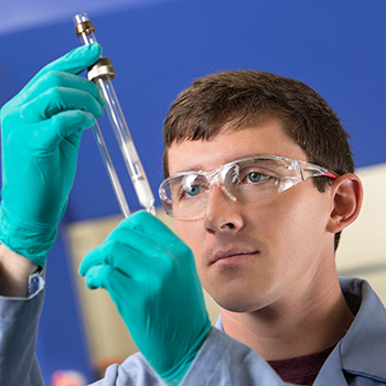 Man wearing goggles working in lab