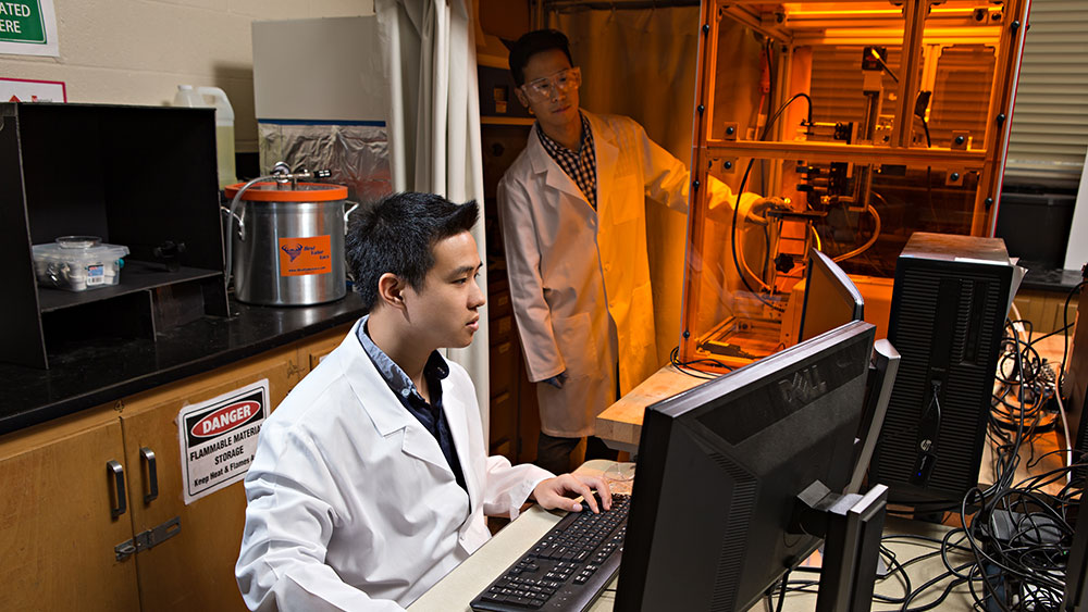 Dr. Bruce Tai and fellow researcher working in a laboratory.