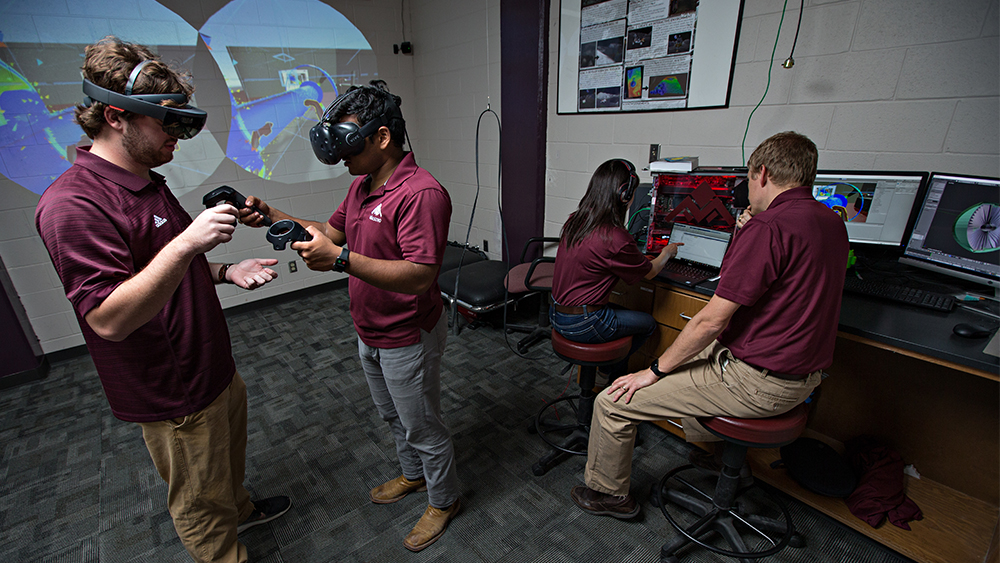Dr. Hartl and students working in virtual reality lab