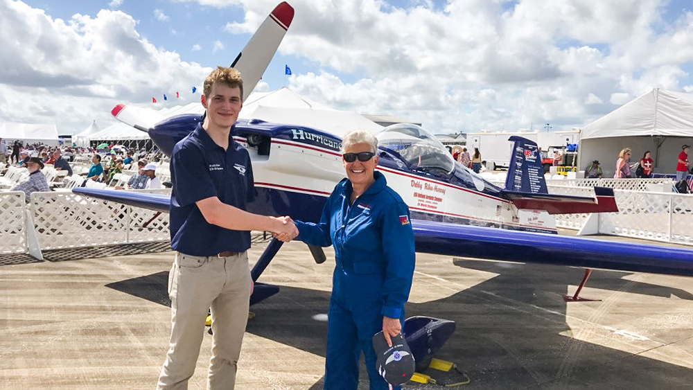 Texas A&M University Aerospace Engineering student, Brady Allen, poses with Debby Rihn-Harvey in front of her plane at the Wings Over Houston Airshow.