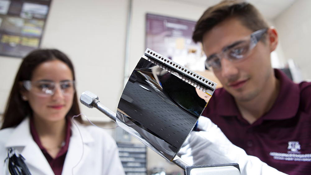 Two Texas A&M University Aerospace Engineering students working on a shape-shifting radiator in the Multifunctional Materials and Aerospace Structures Optimization (MAESTRO) Lab.