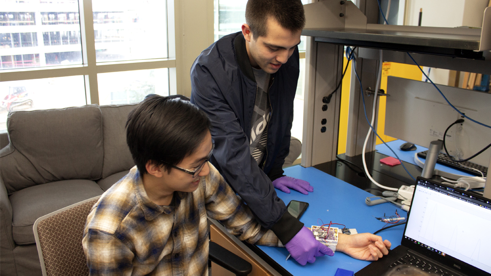 Students work with wired, prototype blood pressure cuff