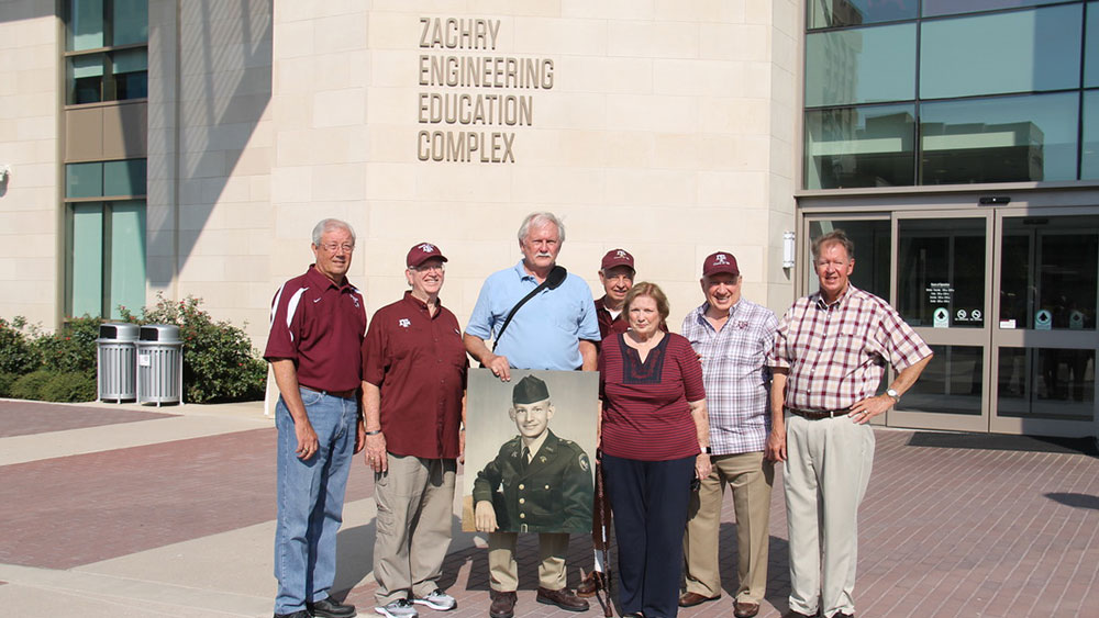 Class of '62 Squadron 13 members in front of the Zachry Engineering Education Complex.