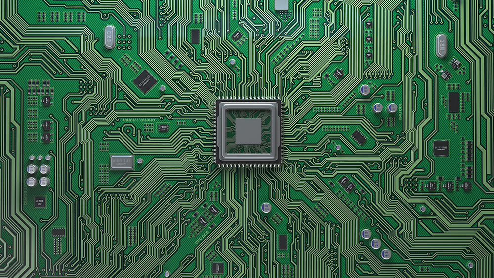 A close-up of a motherboard with a microchip centered in the middle.