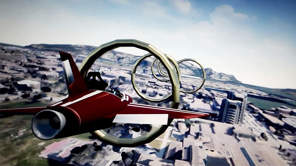 Screenshot of a virtual reality flight simulation showing a maroon and white aircraft flying through large golden rings above a map of Texas A&M University.