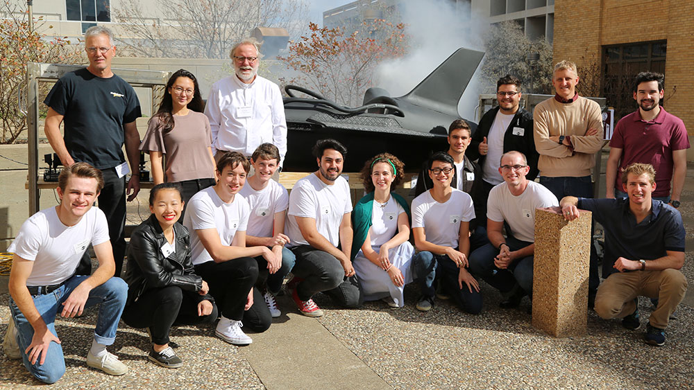 Group photo of Team Retro Rocket with their faculty advisors and rocket car donor.