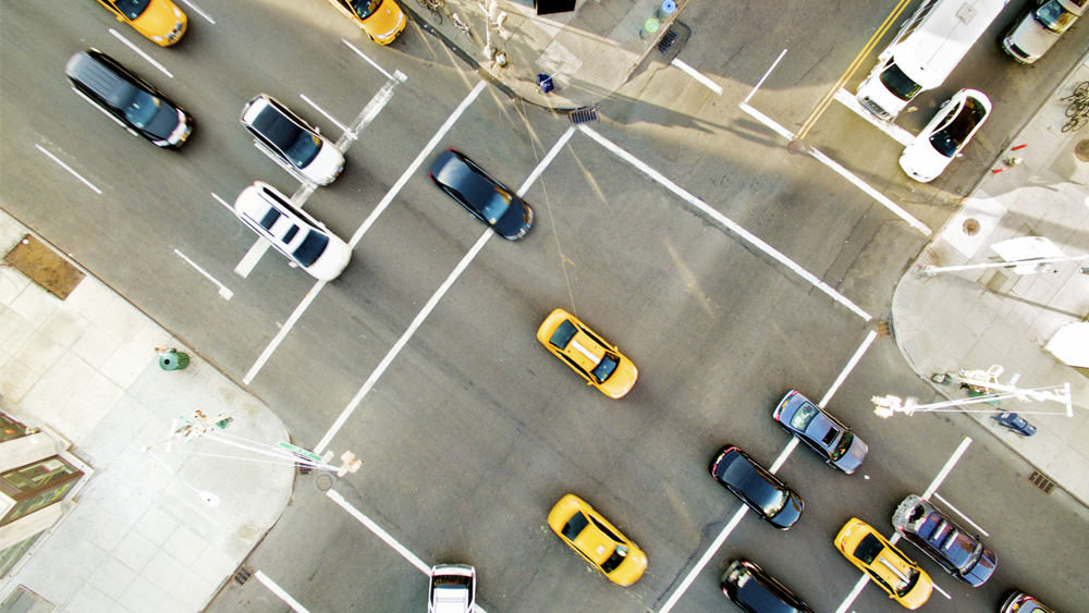 An overhead view of a traffic intersection
